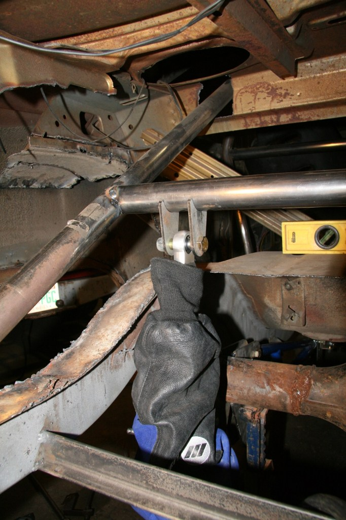 We slid one of our Miller welding sleeves over the shock to protect it (they are nice looking!) and the ears were positioned to the crossmember. It is always best to set the shocks as close to vertical as possible.