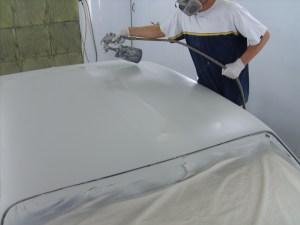 21. Jordan Lewis sprayed the sanded roof with primer-sealer to seal up the metal.