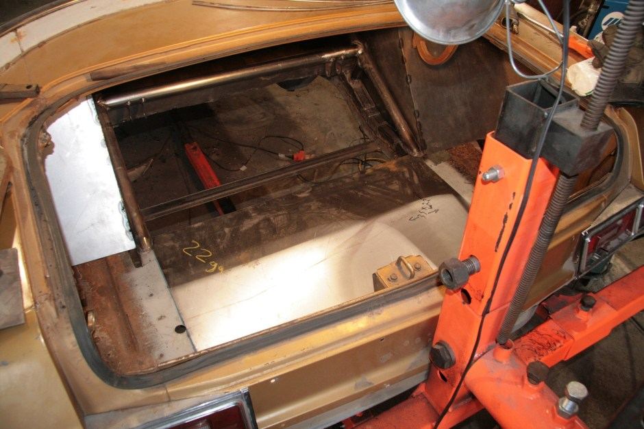 16.We cut the floor panel to fit and stitch welded it in place. With this in place, there is not as near as much room to work as there had been. It is starting to look like a race car.