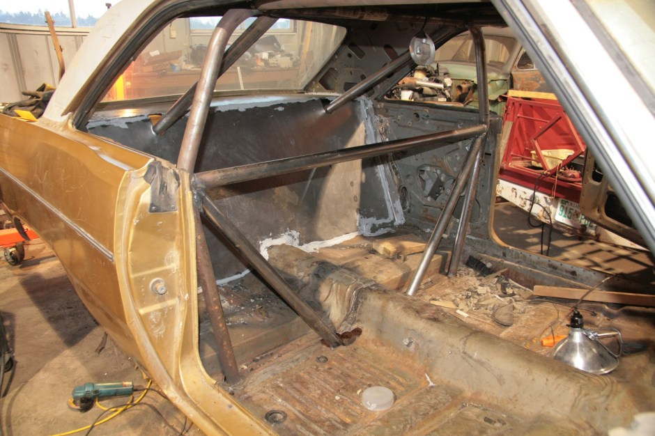 24.The rear firewall got the same sealer treatment. Once this cures and the body work is done, the entire trunk, interior and undercarriage will get sprayed with Al's Liner, which is a tintable bedliner material.