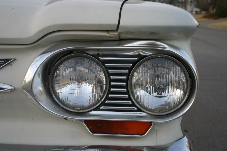 1. While the 1962 Corvair has never been involved in any wrecks, the driver's side headlight bezel owns a serious dent. While these items can be bought on Ebay, why spend the $$$ when it can be fixed at home?