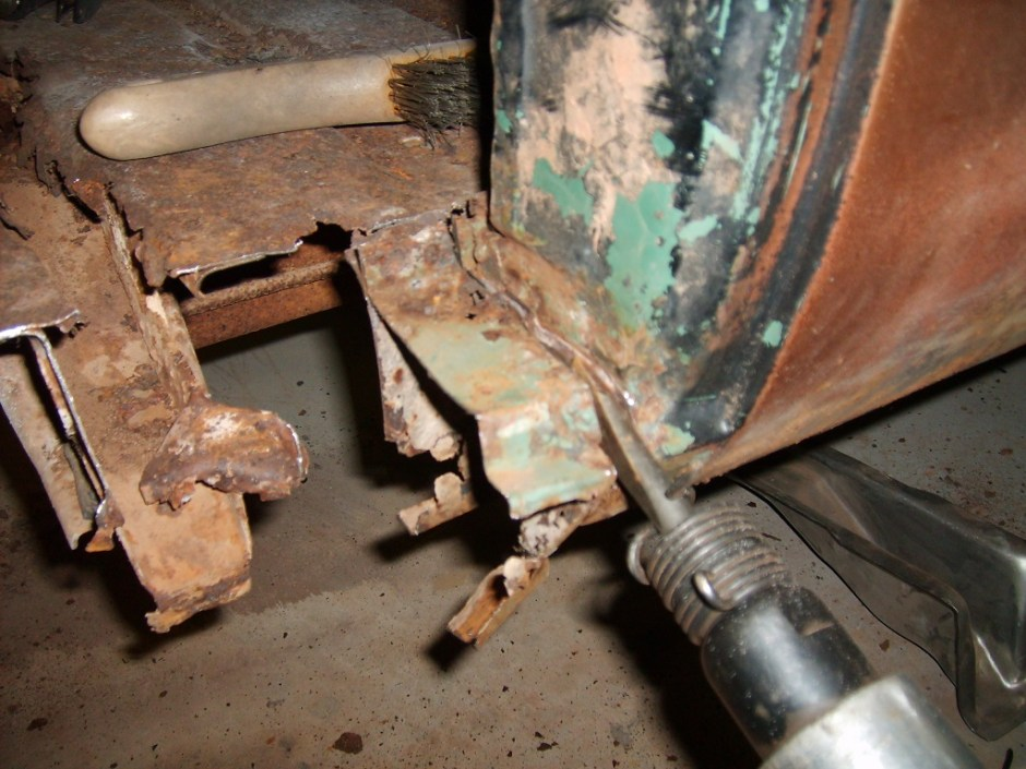 6. Separating some sections of the old rocker required an air hammer and a chisel. Care must be taken here as it is easy to tweak the surrounding metal.