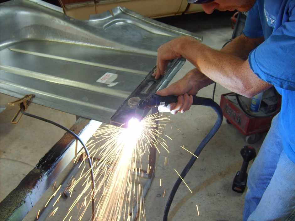 16. Toby Ramsey again uses the plasma cutter and a level (for a straight edge) to trim the main floor sections.