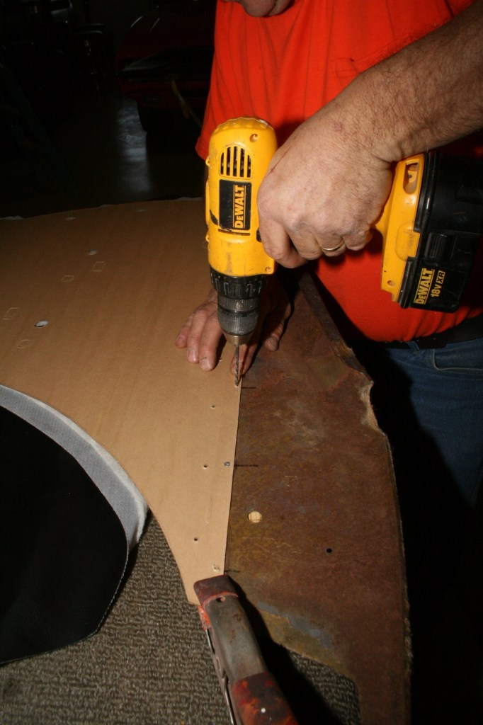 7. The new panel is laid up against the backing plate along the line we marked earlier. A couple of clamps hold it in place while the backing board and metal support were drilled approximately every 6 inches.