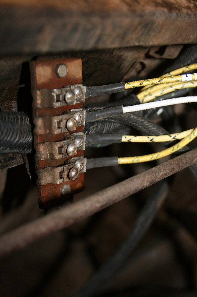 17. The headlight and turn signal wires from the main harness are mounted on the lower portion of the junction box.