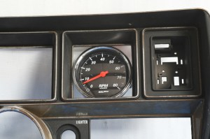 """1.The stock gauge cluster has a square opening that measures 3.5"""". A 3 3\8"""" gauge fits nicely, but needs a backing plate to cover the open spaces."""
