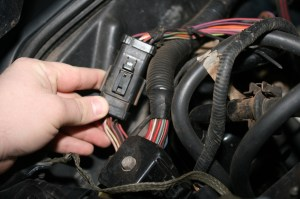 11.The transmission wiring harness is located at the rear of the passenger side of the engine compartment. The old harness simply unplugs and the manual harness plugs in and drops down to the tranny.