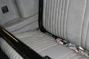 11.The lower rear seat required a little surgery to fit around the roll-cage bars. We marked the original seat cover in the car.