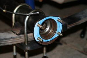 14.The axle tube use 2 gaskets, 1 on the tube, and 1 on on the backing plate, behind the axle shafts.