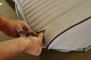 14.Using scissors and a razor blade, Gary Lette of Redline Auto Sports, trimmed out the leather.
