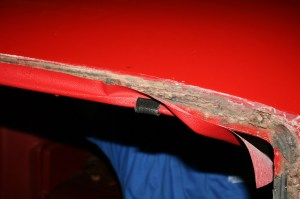 16.Then we stretched the headliner material, keeping it even side to side, and clipped it in place every 3-4 inches with the pinch welt.