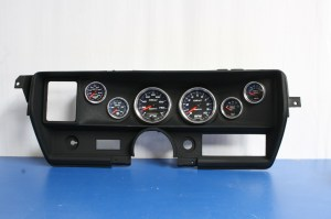 22.With the part dry, the gauges were installed. The scallops below the gauges really add a custom flair to this design. When done properly, this process will work on just about any custom job and is extremely durable.