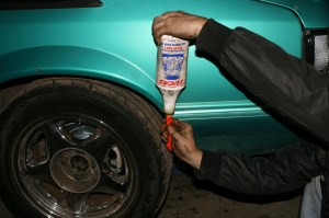 26.There is not much real estate underneath a fox body. We used this little trick to fill up the differential with gear oil. Using a piece of hose, the oil was pumped from outside the car to the rear end. It takes a while, but is easier than the alternative.