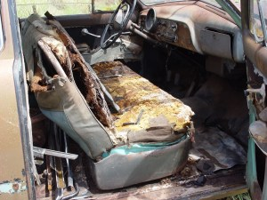 03.After we got the car, the outside still looked great, but the pics of the interior were very misleading. They did not show the rust holes from the firewall back, the entire width of the car. It was the seat that was holding it all together.