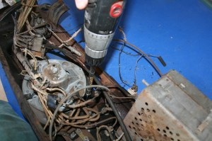 3.The original gauges, radio, and switches were removed. More JB80 was used. Only 2 studs were broken in the process.