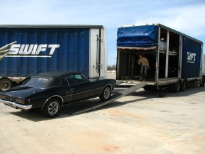 For high-dollar classics like this Firebird, shipping a car in an enclosed trailer is a good idea. These transporters are professionals, note the three other cars already in the truck. Project cars can always be shipped in an open carrier to save some cash in the transport department.
