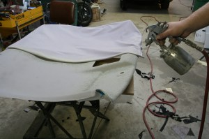 6.The key to this process is quality upholstery glue. You can't do this job with aerosol can glue, it will not hold up, so don't even try it. You need a cheap spray gun, an air compressor, and some quality glue. You can get the glue from your local upholstery shop. Most shops will sell you a gun-full for about $5.