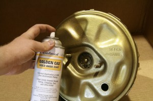 7.First, we laid on the base coat of Golden Cad. If the metal was heavily pitted, we would have primed and sanded it smooth, but this booster was in good shape.