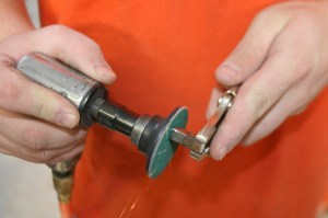 7.Using a die-grinder, we cleaned and added a bevel to the square peg, on each edge, for the weld.