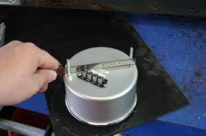 12.The 5-inch Auto Meter gauge was measured on the back side. This measurement was divided into the radius. Accuracy is important here for a good fit.