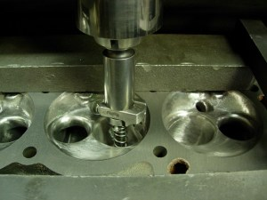 18.The head is set up on the Sunnen machine to cut the competition 3-angle valve job.