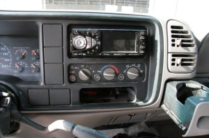 01.The stock dash has a few issues, the empty switch pods to start. You can use a flip-out screen here, but they cost more and the gear shifter is in the way. The solution comes by way of surgery.