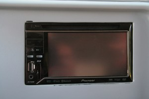 23.In primer, the bezel was installed and the deck was set flush to the bezel. Once positioned, carefully remove the bezel, working hard to not move the head unit. Once the bezel is off, the head unit to cradle sides was measured so spacer mounts could be made.