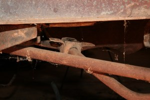 """04.The sway bar to frame mounts were removed along with the sway bar end links. The cobwebs may give you an idea of how """"barn fresh"""" this project really is."""