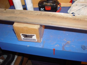 6.The far side of the rocker trim is supported with a cardboard box.