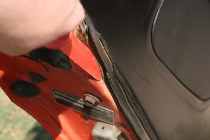 9.The plastic scraper was used to separate the rubber from the door and to remove as much old glue as possible.