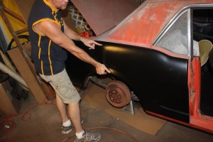 03.We ordered a new skin from 1-800-Mustang, and it fit quite well, considering its $59 price. We set the panel to the car and marked the top line of the new panel on the car. This will serve as our overall fit line.