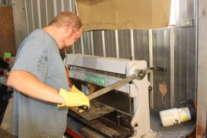 12.Then we cut it out using the 3-in-1 metal machine from Woodward Fab. This machine cuts, bends, and rolls up to 18-gauge steel, it is a godsend for any sheetmetal fabricator.