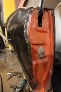 20.Then we spot-welded it in place. You want to work from one end to the other, so that you can work out the kinks along the way. Always start at the door, working backwards, welding up the tail panel last. That is where you have the most adjustment room.