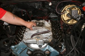 3.The engine had an Edelbrock Performer intake which is better than stock, but not quite up to par with the rest of the new parts, so it goes on the spare parts shelf. We also pulled the water pump\timing cover.