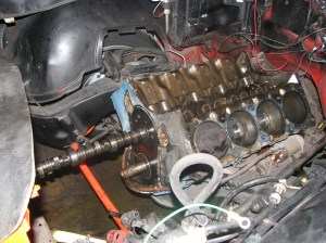 6.The old cam slides right out. We didn't want to change the cam bearings, so we removed the cam slowly and carefully.