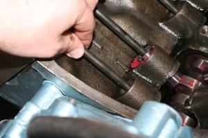 18.The pushrods and rockers were installed, then the valve lash was set. Setting the valve lash on hydraulic lifters is done by rolling the motor over to just past valve opening, then tightening the rocker until the pushrod just stops moving, and then a 1\4-turn more.
