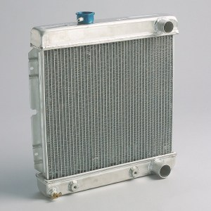 12. Another solution would have been an aluminum radiator like this direct-fit piece from Summit Racing. This radiator is a 2-row core. While copper and brass radiators are technically more efficient heat conductors, aluminum radiators can be made with thinner wall thicknesses, allowing the builder to fit more tubes and fins, which increases the radiators ability to conduct heat.