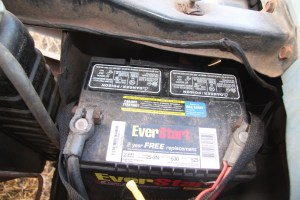 2. This is a conventional flooded battery with maintenance caps, which are the two blocks at the top. This is the most common type of battery you will encounter.