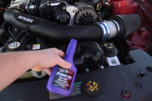 26. The intercooler is air-to-liquid, so it requires coolant. We used some Purple Ice additive which breaks down the surface tension of the water/antifreeze mix, allowing the coolant to transfer heat better, which reduces the overall temperature. Only about an ounce is needed for the intercooler's small capacity, so we added the rest to the engine coolant.