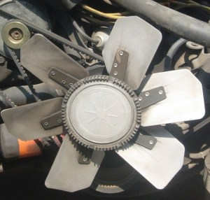 Smaller motors with a clutch fan use a centrifugal clutch. These clutches are identified by a smooth front cover like this. These fans loosen up at higher RPMs, reducing the draw on the engine, similar to a flex fan.