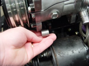 2.The new Sanden compressor mounts to the bracket using 4 bolts and a couple of spacers on the front.