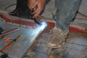 18.The pan was then stitch welded in place. Stitch welding is done by placing a series of tack welds every few inches until the entire perimeter is welded. This reduces warping.