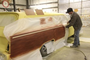 16.Once the entire side of the car was completed in the base grain, we masked off the area for the trim wood. We used a 1—inch border around each section.