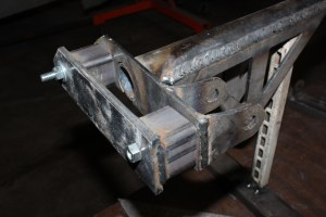 16.These adapters increase the width of the upper crossmember and match the angle of the subframe. We bolted them to the upper crossmember and welded them in place.