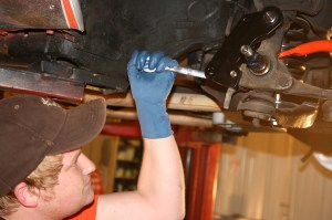 21.With the help of Red Line Autosports, they put some torque on the lower mounting bolt for the caliper bracket.
