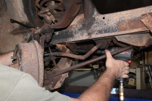5. Using an impact wrench and a back-up on the other side, we loosened the lower control arm mount, but left the bolt in place.