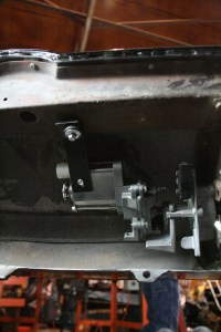 17. The motor is secured to the car with a metal bar that bolts to the nose support beam. The bolt that holds this in place is really thin. Ours broke, and we had to drill it out. Be careful.