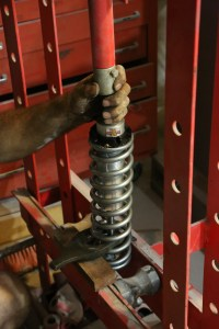 35. The springs for our car were quite stiff, so much so we had to use a press to get the upper spring keeper in place.