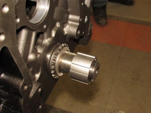 2. We slipped the crank gear and oil pump ring onto the crank snout.