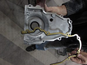 9. There are two timing covers for LS-series engines; one for a front cam sensor, one for a rear sensor. We have a front sensor cover, which has a hole in it. The gaskets on LS engines are almost all reusable o-ring-type, even the timing cover gasket. We used Fel-Pro gaskets on this build.